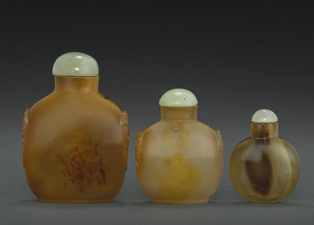 A group of three agate snuff bottles