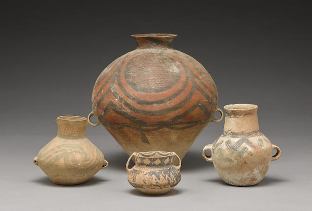 A group of four painted pottery jars