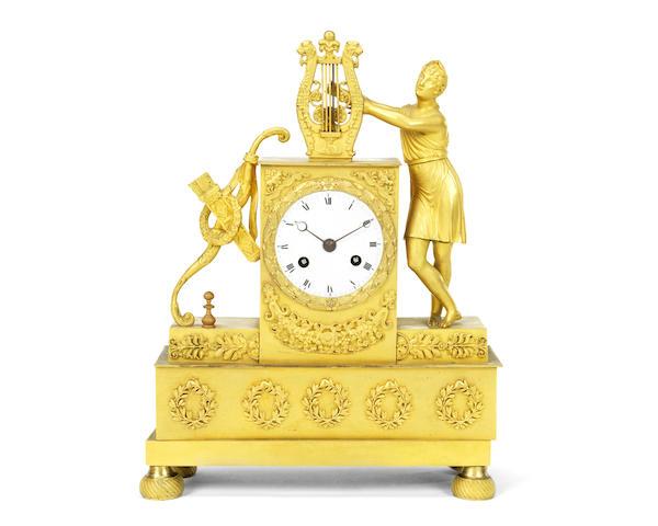 A Restauration gilt bronze figural mantel clock