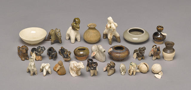 A group of miniature pottery models of animals and containers
