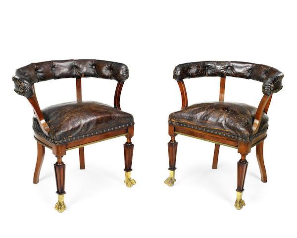A near pair of 19th century mahogany tub back armchairs