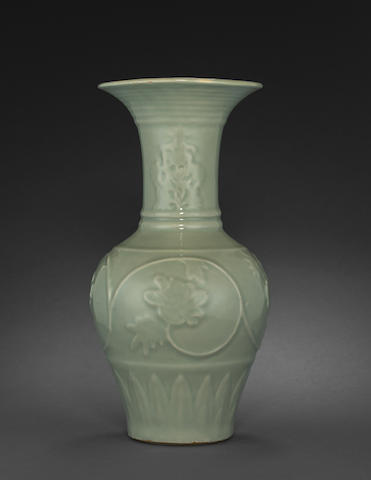 A fine and rare Longquan celadon vase with molded decoration