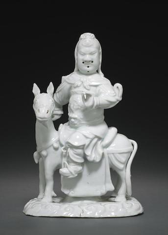 A Dehua figure of a mounted Guan Yu