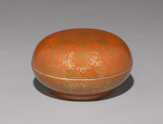 A large coral red and gilt decorated circular box