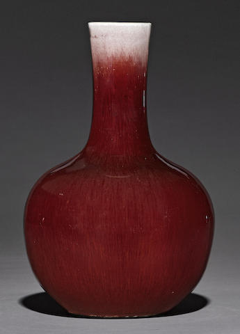 A transmutation red glazed stick neck vase