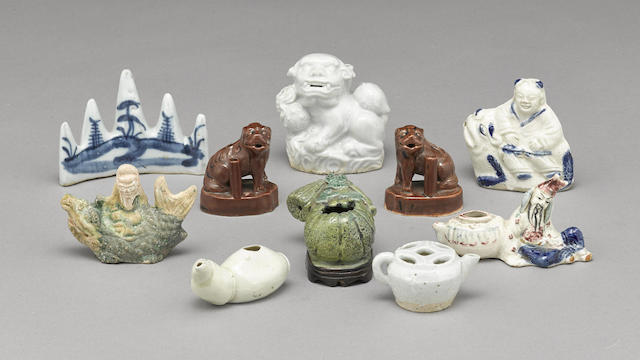 A group of ten ceramic water droppers and water coupes
