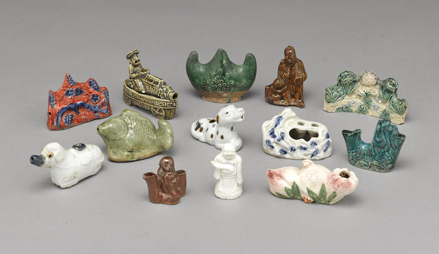 A group of thirteen ceramic water droppers and water coupes