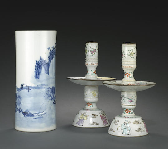 A pair of famille rose enameled candle stands