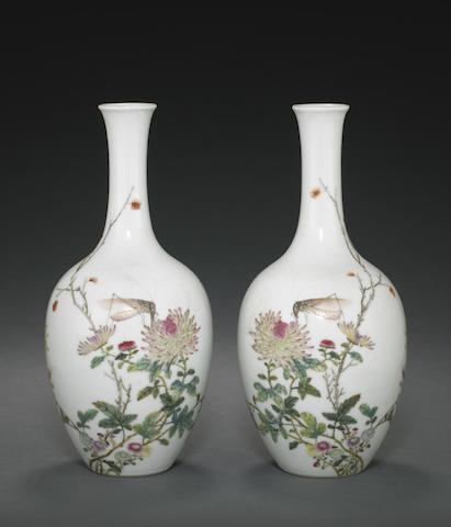 A pair of famille rose enameled bottle vases