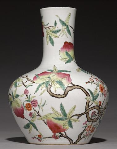 A famille rose enameled Nine Peach stick-neck vase