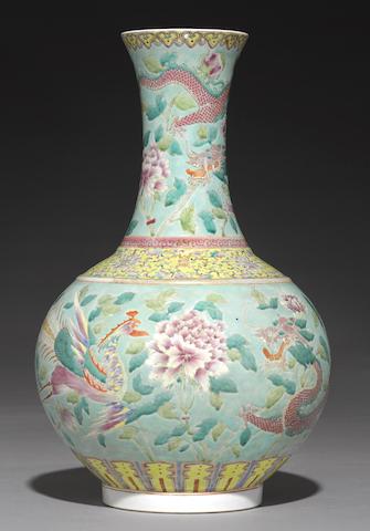 A famille rose enameled bottle vase