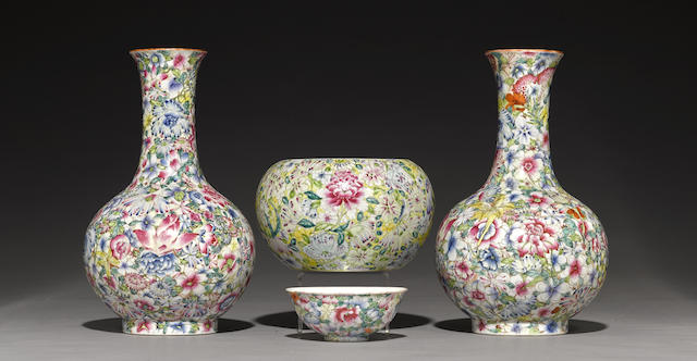 A group of millefleur decorated containers