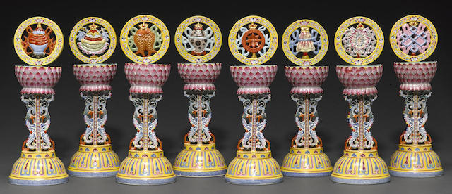 A set of polychrome enameled Eight Buddhist Emblems on plinths