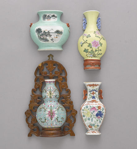 A group of eight famille rose enameled wall vases