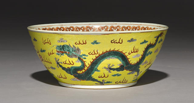 A yellow ground and famille verte enameled dragon bowl