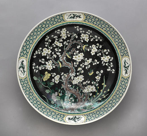 A large famille noire enameled charger