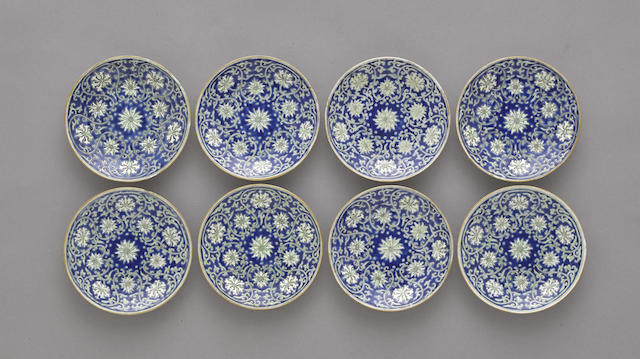 A set of eight polychrome enameled saucer dishes