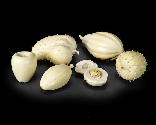 A collection of late 19th / early 20th century Japanese carved ivory fruit and vegetables