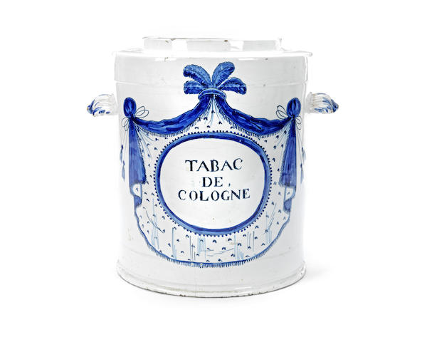 A late 18th / early 19th century Dutch Delft tobacco jar together with three Dutch Delft plates