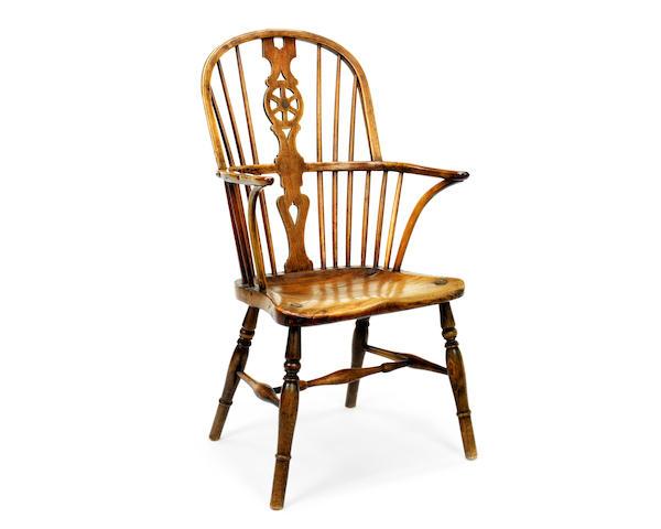 A 19th century elm wheelback Windsor chair