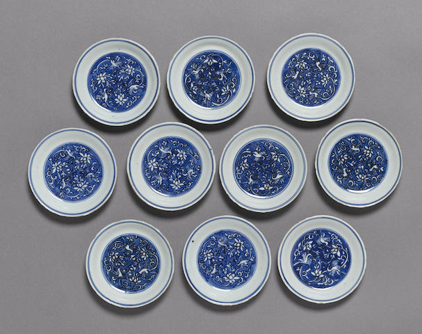 A set of ten blue and white 'crane' saucer dishes