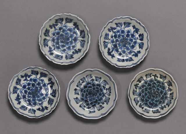 A group of five small blue and white dishes