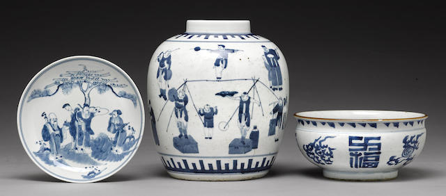 A group of three blue and white containers