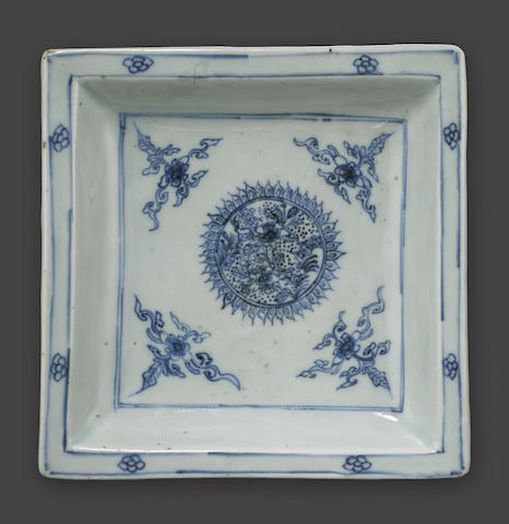 A blue and white square dish
