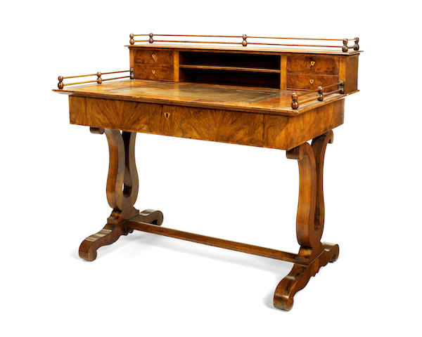A mid 19th century Biedermeier walnut writing table