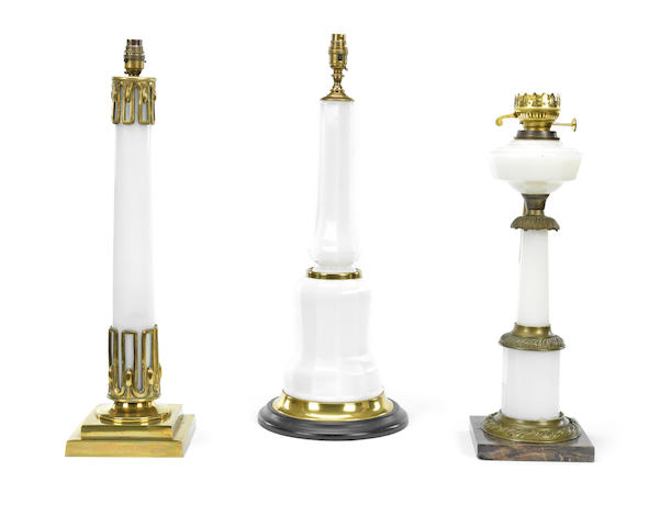 Three brass mounted opaque glass lamp bases