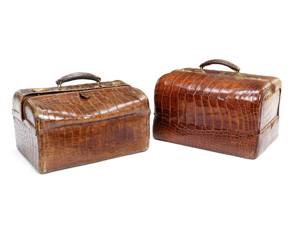 Two late 19th century/early 20th century crocodile Gladstone bags