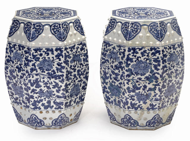 A pair of blue and white garden stools of octagonal section