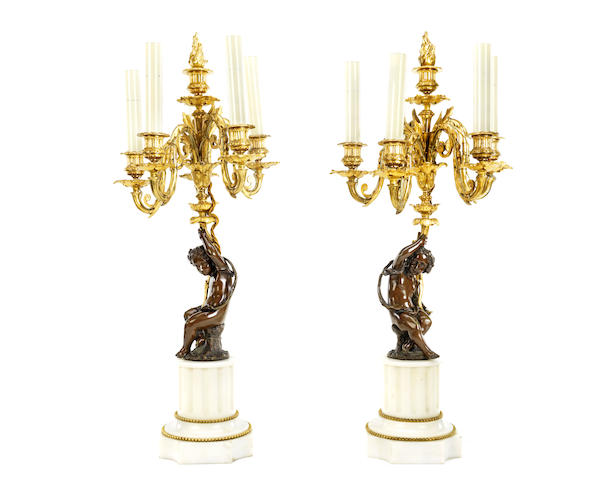 A pair of third quarter 19th century French bronze and gilt bronze figural candelabra