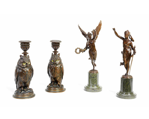 A pair of spelter candlesticks modelled as owls