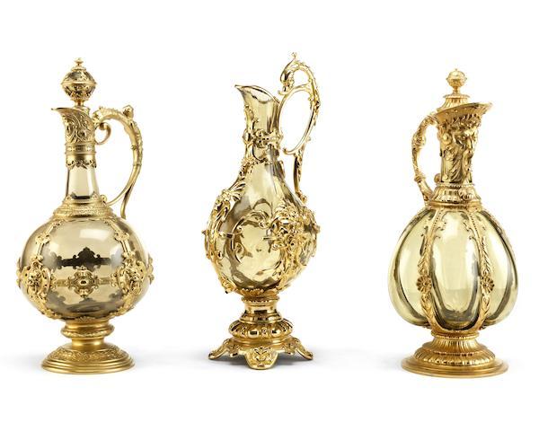 Three Renaissance style gilt metal and glass ewers