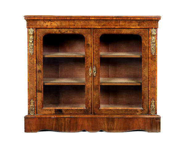 A Victorian walnut and tulipwood banded low display cabinet