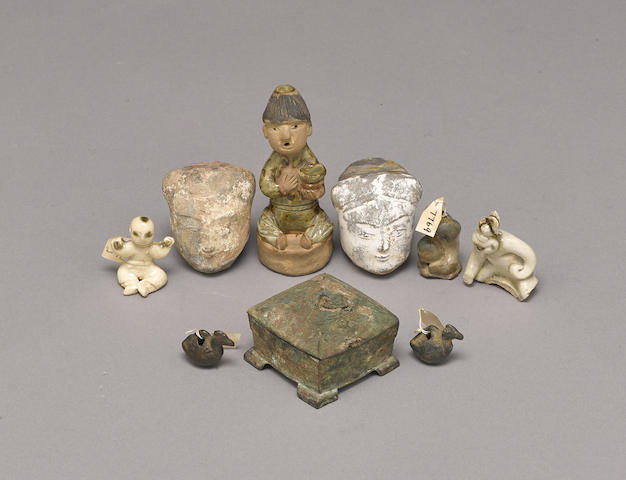 A group of early bronze and pottery decorations