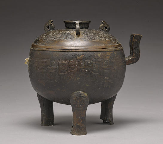 A cast bronze covered archaistic tripod, ding
