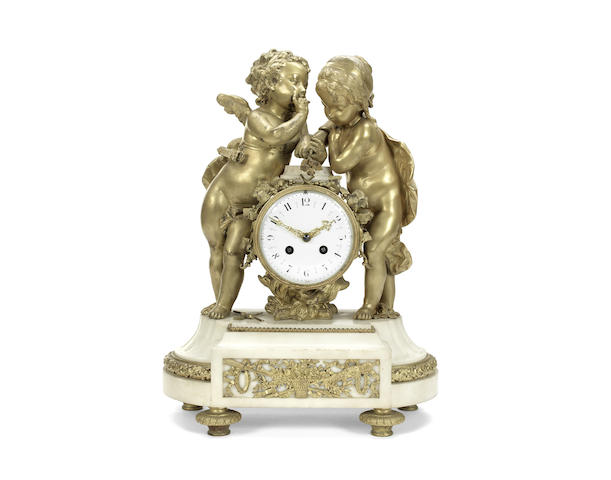 A late 19th century French gilt bronze and white marble figural mantel clock