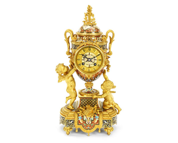 A late 19th century French gilt bronze and champlevé enamel figural clock