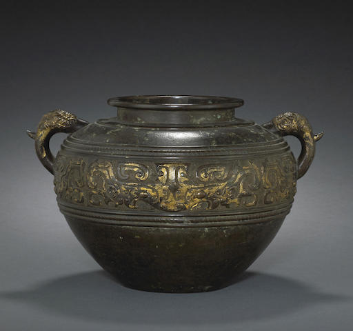 An archaistic bronze two-handled jar with gilt-washed decoration, lei