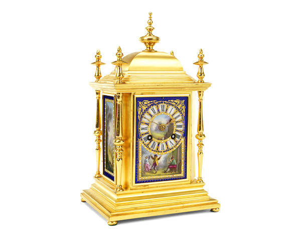 A late 19th century French gilt metal and Sevres style porcelain mantel clock