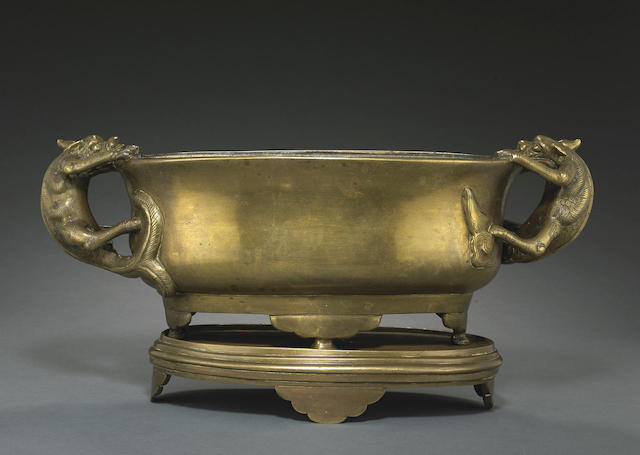 An ovoid bronze censer with stand
