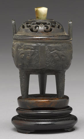A small bronze tripod censer, Ding