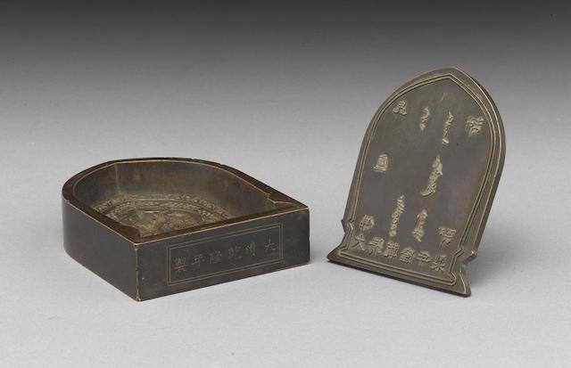 A cast bronze tsa tsa mold