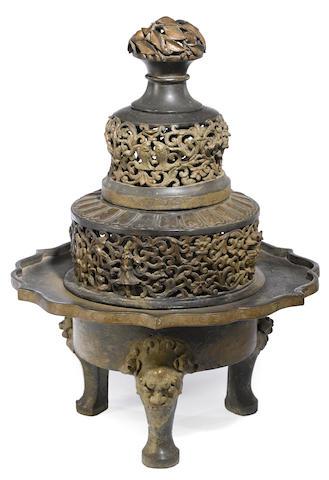 A cast bronze tripod censer and cover