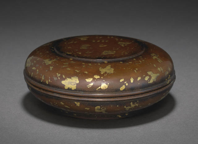 A gold-splashed bronze covered box