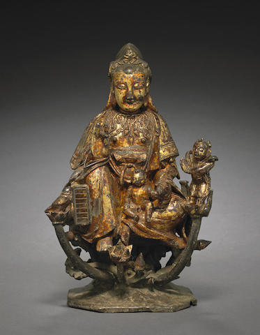 A lacquered bronze figure of guanyin