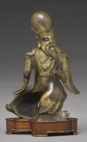 A bronze figure of Shoulao with applied gilt accents
