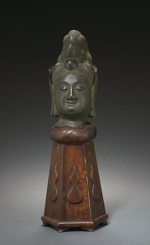 A bronze head of a female deity